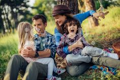 Photo of a family having picnic in the forest royalty-free stock photo