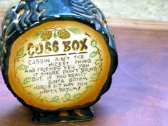 This is a quaint vintage ceramic swear jar, or 'Cuss Box' coin bank with an Appalachian hillbilly motif that was made in Japan. This penny bank is molded like a cross cut section of pine tree with pine cones decorating . Stock and custom banks that can be custom imprinted for your business or organization
