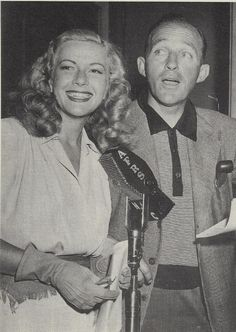 "Bing Crosby with Armed Forces Radio's Martha Wilkerson, better known as ""G.I. Jill"" who was radio sweetheart of countless servicemen during World War II. The pretty disc-jockey brought music and a bit of home to all the boys on the front through the magic of radio."
