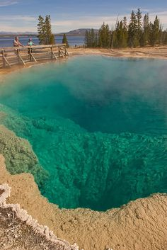 ˚The Black Pool at West Thumb Geyser Basin in Yellowstone National Park in western Wyoming and the Idaho, Montana border