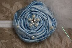 http://www.etsy.com/listing/80095999/cinderella-princess-rosette-on-shiny    On a black headband/ear warmer.
