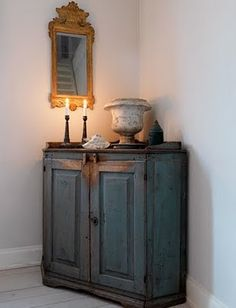 MMmmmmm.... Nicole has a corner cabinet like this that needs painting.  This is lovely!