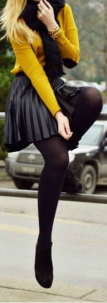 Pleated skirt, black boots, yellow sweater and tights. Perfect Fall look!