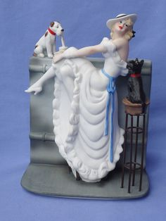 Icart deco lady w Fox terrier & Scotty.  What is the dalmation doing?