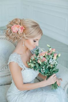wedding updo hairstyle with pink flowers