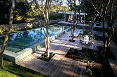 Great courtyard concept with an emerald green lap pool...the rocks can be quarried from around the area