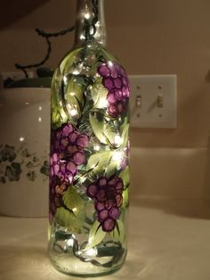 Lighted wine bottle : grapes and leaves; have also seen it crafted with glass beads glued to the side, so pretty. painted wine bottles, paint wine, night lights, paint glass, christmas lights, light wine, winery weddings, winebottl, lighted wine bottles