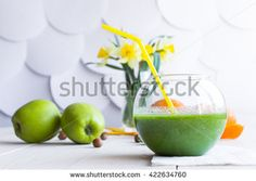 green cocktail in a transparent glass on a white wooden background - stock photo