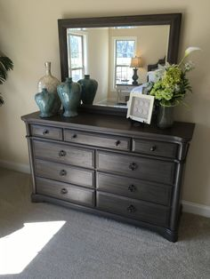 How to stage a bedroom dresser with vases, urns, frames and flowers