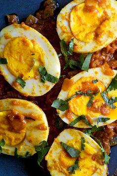 Ande ki Kari (Eggs in Spicy Tomato Sauce) Recipe Egg Recipes, Sauce Recipes, Indian Food Recipes, Great Recipes, Vegetarian Recipes, Cooking Recipes, Favorite Recipes, Popular Recipes, Spicy Tomato Sauce