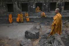 Monks at Preah Vihear Temple, a disputed territory ruled in 1962 by the International Court of The Hague to belong to the Cambodian nation, Preah Vihear, Cambodia, 2008, photograph by John Vink. In recent years the temple has seen renewed efforts by Thai officials to shift the border around it, leading it to pursue protective measures by being nominated as a potential UNESCO World Heritage site by the United Nations.
