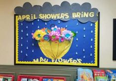 April showers bring may flowers bulletin board Toddler Bulletin Boards, Flower Bulletin Boards, Easter Bulletin Boards, Office Bulletin Boards, Bulletin Board Borders, April Bulletin Board Ideas, April Showers, Preschool Crafts, Preschool Door