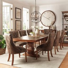 Constructed of poplar wood with a beautiful oak finish, this set is finished with eight suede-upholstered chairs. Eating dinner at this stunning dining set will always be an enjoyable experience.