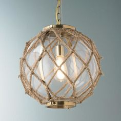 Chandelier or overhead light that looks like it's made of a fishnet float;  Plain glass bulb wrapped in hemp?