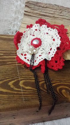 Check out this item in my Etsy shop https://www.etsy.com/listing/209679100/cotton-lace-crochet-pearls-brooch
