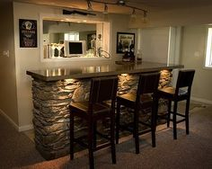 Family Room bar, really like the lighting under the counters and the huge mirror on the back wall. the stone feature is stunning.