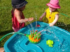 Water table with mini sprinkler