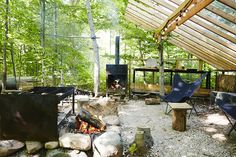 """Joel, a landscape designer, created """"a series of outdoor rooms,"""" including an alfresco kitchen that is sheltered beneath a cedar trellis. The Butterfly chairs are from Fresh Home and Garden in Toronto."""
