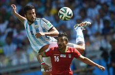 Ezequiel Garay battles for the ball with a member of Iraqs team Star Wars, Fifa World Cup, Soccer Ball, Brazil, Baseball Cards, Sports, Iran, June, Argentina