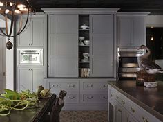 gray built-in hutch with sliding doors + black ceiling (Wendy Posard)