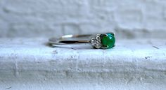Lovely Vintage 14K White Gold Diamond and Cabochon Emerald Ring - 0.69ct. by GoldAdore on Etsy https://www.etsy.com/listing/218218375/lovely-vintage-14k-white-gold-diamond