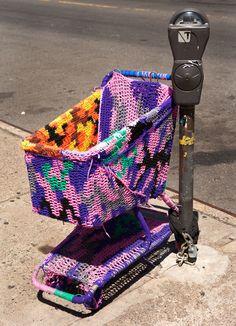 yarn-bombed shopping trolley