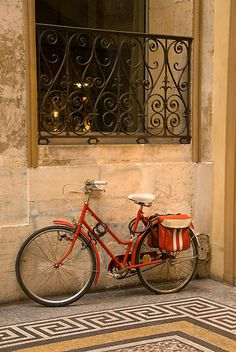 Parisan Bicycle by Craig Goldsmith.  This darling red bike was found in one of the few remaining galleries in Paris.