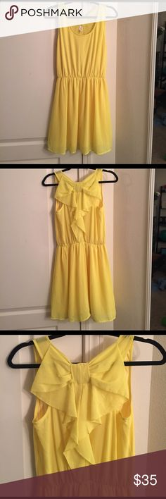 Francesca's yellow bow dress Worn twice, great condition, really cute bow on the back! Francesca's Collections Dresses