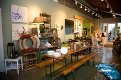 Red Daisy  A unique gift shop that combines the old with the new. New items mixed with antiques and vintage finds make this shop a destination. With inventory that is constantly changing, you're sure to find the perfect gift.