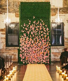15 Gorgeous Indoor Wedding Backdrops To Try: a living wall with real orange and pink blooms and a couple of glam chandeliers completely changes the venue