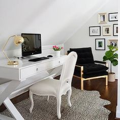 Chic, glam office with white lacquer desk, gold desk lamp, white Frenchchair, cheetah rug and an art gallery wall | JWS Interiors