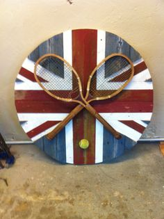Reclaimed wood from an old farm turned into a round Union Jack with a Wimbledon twist to it.