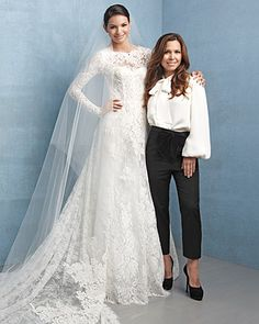 Designer Monique Lhuillier with one of her stunning lace gowns