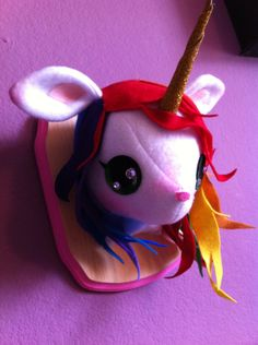 Rainbow Unicorn Plush Taxidermy. $60.00, via Etsy.