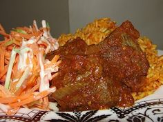 Jollof Rice, Stewed Beef and Carrot Slaw