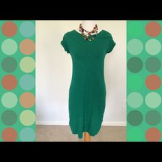 """Banana Republic T shirt dress Beautiful green Banana Republic short sleeve T shirt dress. Has small gold button on sleeve. I'm 5""""4 it stops right above my knee. Super soft and comfy. Excellent condition. Banana Republic Dresses Mini"""