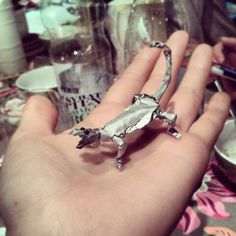 Lizard made of foile. Eyes made of chocolate sauce.