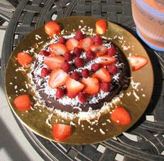 My super simple, quick, light and delicious raw vegan chocolate cake - only 5 ingredients and 10 mins to make. 3 cups of walnuts, 20 pitted medjool dates, 2/3 cup raw cacao, 2 tsp vanilla extract, 1/4 tsp sea salt...put walnuts and dates in processer first until blended to nice consistency, don't over-do but a little smaller than a pebble, larger than grain of salt, then add the rest and blend, then mold into shape you want and decorate as you choose.