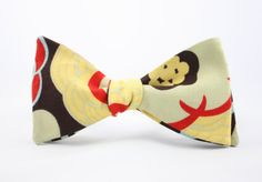 Floral Bow Tie Handmade by LW by Lord Wallington is ready to help you get in the mood for spring. This handcrafted bow tie is the perfect addition to your spring wardrobe.