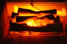 Fake Burning Fireplace Logs Fake Fireplace Logs, Distressed Fireplace, Rustic Fireplaces, Christmas Fireplace, Fireplace Inserts, Fireplace Design, Plaza Hotel, Fake Instagram, Office Christmas Decorations