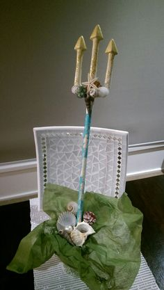 Mermaid trident decoration for mermaid party. Made using a plastic devils pitchfork.