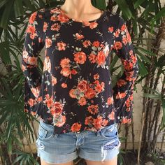 Bell Sleeve Flower Top In perfect condition. Beautiful top with soft, breathable fabric. Bell sleeves which are so in for spring! Tops Blouses