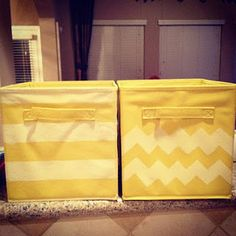 Fabric Bins Baskets redone using painter's tape and spray paint. such a good idea!