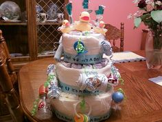 3 tier round boy diaper cake: simple boy diaper cake: contains rubber duckies, diapers, bottle, rattle, keys, pacifier, and much more
