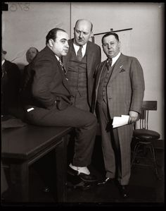 Al Capone, Asst. State Attorney Frank Mast and Bailiff Joe Weinberg in a Chicago Federal Building courtroom, April 4, 1931