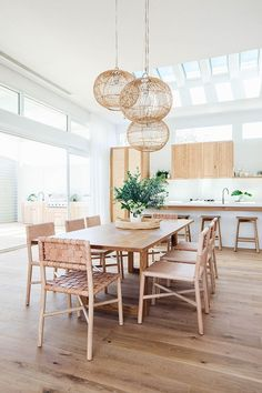 breezy & beautiful dining room overlooking kitchen / multiple woven globe pendants above dining room