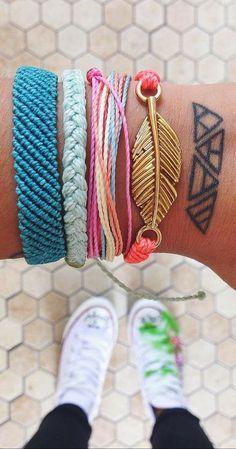 Triangle tattoos plus Pura Vida Bracelets are all handmade in Costa Rica.