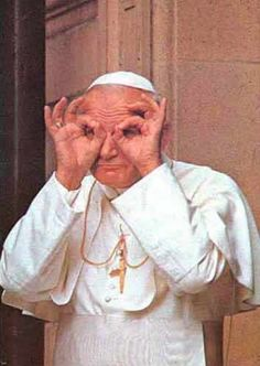 John Paul II  - Some say that on this picture he is mocking the Communist observers across the Berlin Wall, the others that he was just being silly with kids.  Either way this is one of my favorite pictures