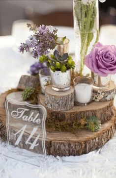 Rustic Stacked Wood Centerpiece: Perfect for rustic centerpiece lovers! I love how earthy and woodsy this centerpiece looks. If you are having a rustic or shabby chic wedding or you're throwing a dinner party and your home has a shabby chic or rustic country cottage kind of style, then this idea is absolutely perfect for you! If you have a friend who has to cut down trees or can do some lumber work then you've got a inexpensive and easy centerpiece idea.
