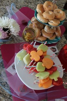 Alice in Wonderland---use small cookie cutter to make designs for fruit and then put on kabob sticks